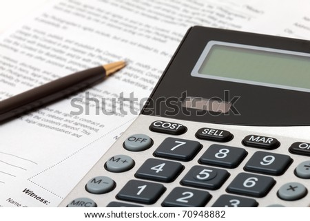 Calculator, pen and contract - business situation