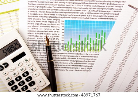 Calculator , pen, numbers and graph