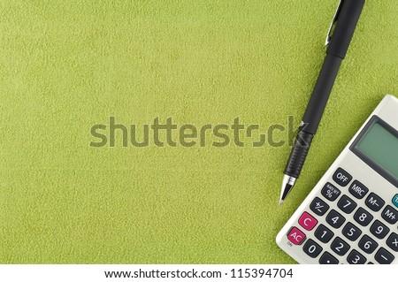 Calculator pen on fabric