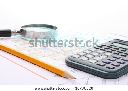 Calculator,pencil,magnifier and drafts