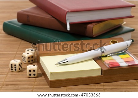 Calculator, pens, dice and financial concept