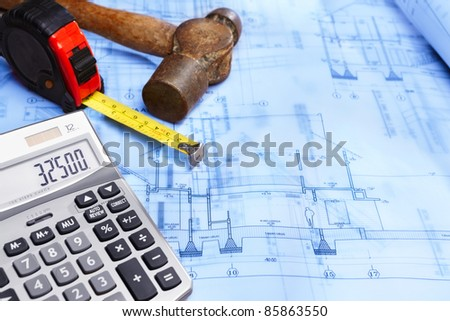 Calculator showing number on top of house design blueprint
