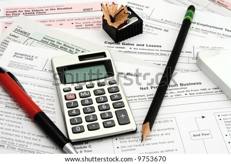 Calculator tax forms pen pencil eraser sharpener