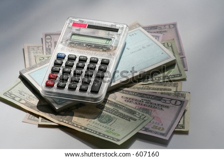 calculator, US money and checkbook - stock photo