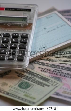 calculator, US money and checkbook