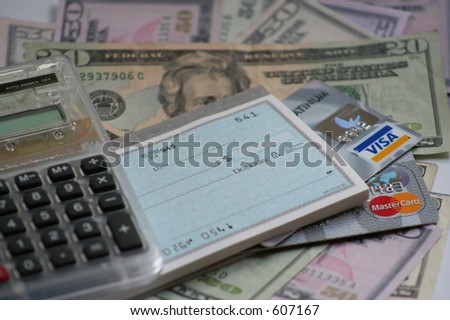 calculator, US money, credit cards and checkbook