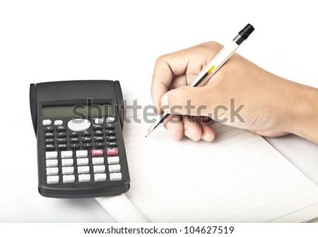 calculator with hand writing - stock photo