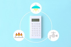 Calculator with light, water and gas system clip art on light blue background