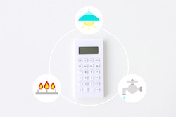 Calculator with light, water and gas system clip art on white background