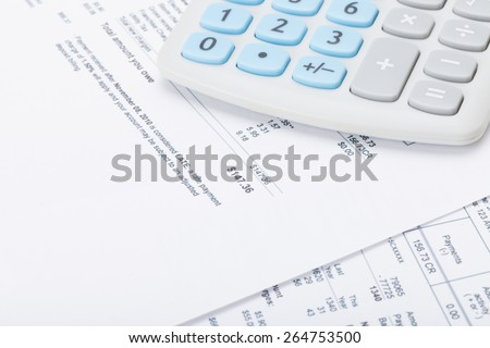 Calculator with monthly utility bill under it