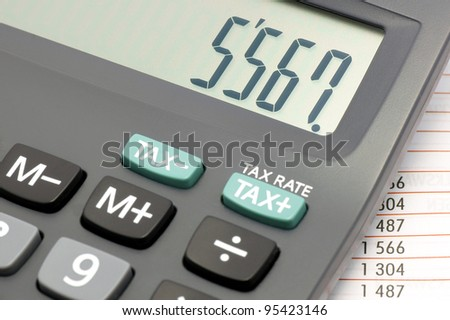 Calculator with numbers superimposed on the price list.