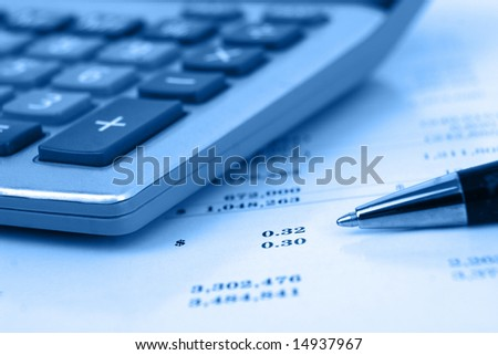 calculator with pen blue overlay on statement side view with shallow depth of field