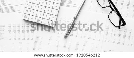 Calculator with pen on financial data. Concept of Business and Finance research . Stockfoto ©