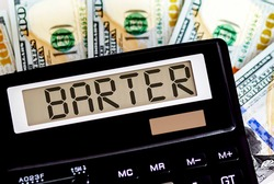 Calculator with text BARTER on dollars. Business, finance conceptual.