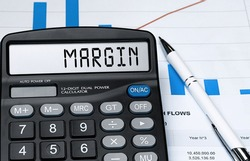 Calculator with the word margin on the display. Money, finance and business concept