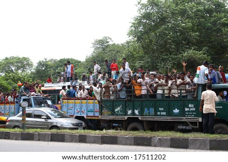 CALCUTTA, INDIA - JUNE 15: a group of hindu people riding the then political meeting June 15, 2008 in Calcutta, India