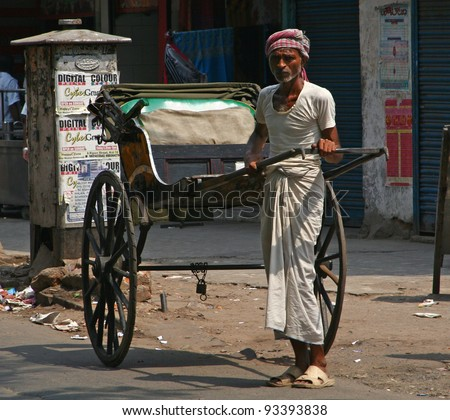 CALCUTTA - MAY 21: rickshaw driver working on May 21, 2011 in Calcutta, India. Rickshaws have been around for more than a century, but they could soon be a thing of the past. - stock photo
