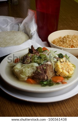 caldo / Caldo de res. Is a Mexican stew served with meat vegetables and rice.