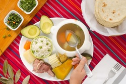 Caldo de res, a traditional Guatemalan dish, made with meat and vegetables.