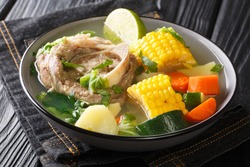 Caldo de Res is a Mexican beef soup that's hearty enough to be a main meal and the perfect dish to make during the winter closeup in the plate on the table.