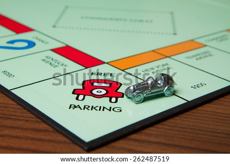 CALDWELL, IDAHO/USA - MARCH 16, 2015: Car pulling into the Free Parking spot in Monopoly