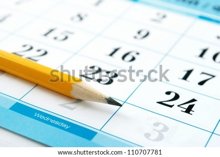 calendar and a pencil to mark the desired date