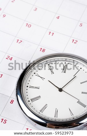 calendar and clock close up shot