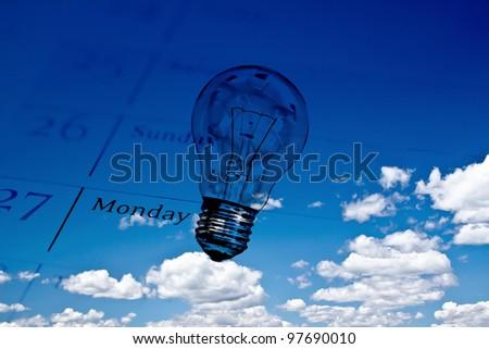 calendar and lightbulb on sky: concept of creativity/innovati on - stock photo