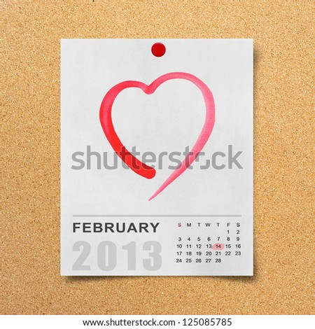 Calendar 2013 and red heart on note paper background.