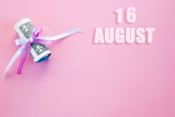 calendar date on pink background with rolled up dollar bills pinned by pink and blue ribbon with copy space. August 16 is the sixteenth day of the month.