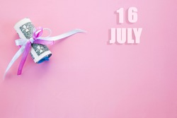calendar date on pink background with rolled up dollar bills pinned by pink and blue ribbon with copy space. July 16 is the sixteenth day of the month.