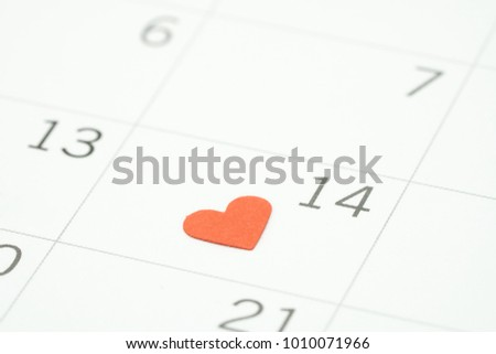 Calendar. Day 14 meets Valentine Day with Heart shaped red paper. Red heart is the promise of love. using as background Valentine concept with copy spaces for you