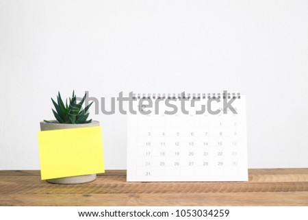 Calendar December 2018 on table and note paper #1053034259