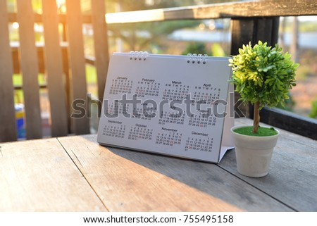 Calendar desk place on table.Desktop Calender for Planner to plan agenda, timetable, appointment, organization, management each date, month, and year on wooden office table.Calendar Concept.
