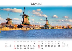 Calendar May 2021, B3 size. Set of calendars with amazing landscapes. Authentic Zaandam mills on water channel in Zaanstad willage. Zaanse Schans Windmills and famous Netherlands canals.