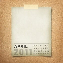 Calendar 2011 Note paper pined on cork board. april