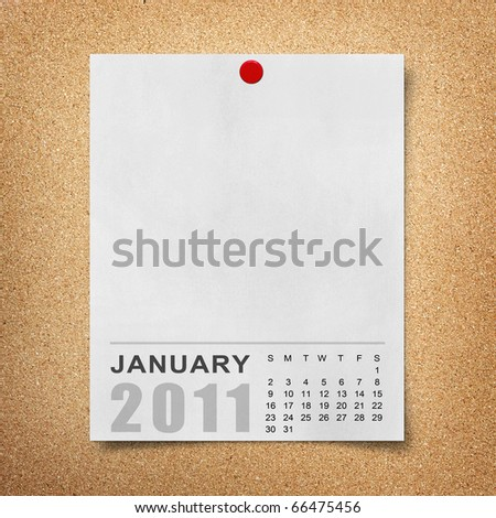 Calendar 2011 Note paper pined on cork board. january