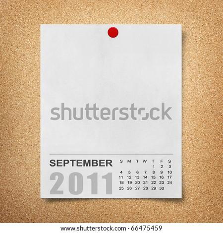 Calendar 2011 Note paper pined on cork board. september