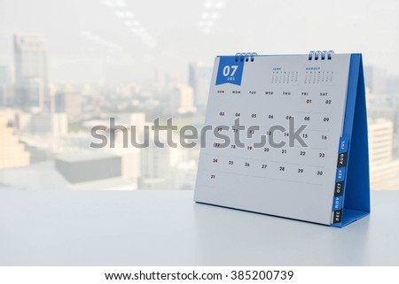 Calendar of July on the white table with city view background #385200739