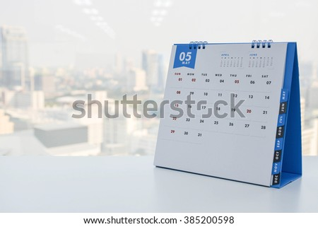 Calendar of May on the white table with city view background #385200598