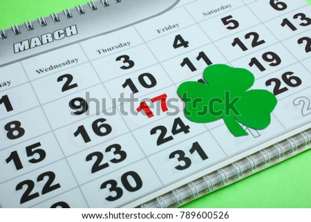 Calendar on a green background, March 17th. Concept day of St. Patrick.