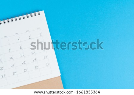 Calendar on blue background with copy space and blank space to put month and year using as reminder, plan and appointment concept.