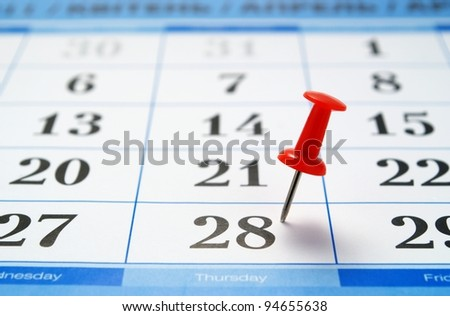 calendar page and a red pushpin, mark the date