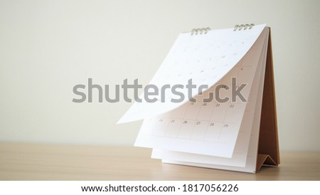 Calendar page flipping sheet on wood table background business schedule planning appointment meeting concept ストックフォト ©