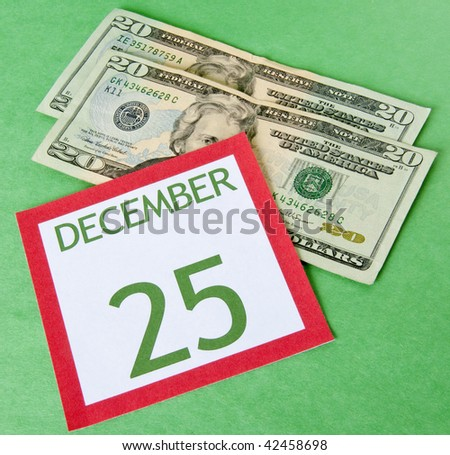 Calendar page with currency for a tight budget this Holiday season.
