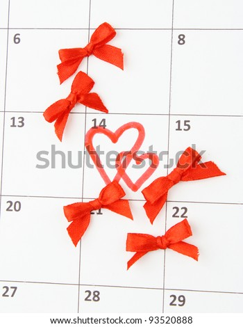 Calendar page with hearts and bows on St.Valentines Day