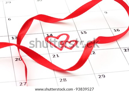 Calendar page with hearts and ribbon on St.Valentines Day