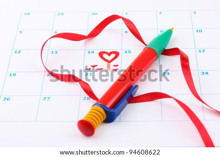 Calendar page with hearts, pen and ribbon on St.Valentines Day