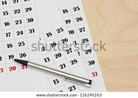 Calendar pages lying on a desk, closeup