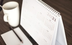 Calendar 2021 schedule with blank note for to do list on wooden desk